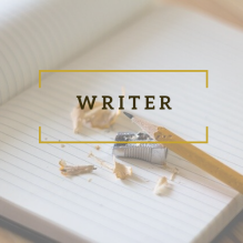 """Writer,"" overlaid on a notebook with a pencil and sharpener"